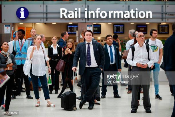 Commuters stand on the concourse at London Waterloo rail station in central London on August 7 as Network Rail commences major work to upgrade the...