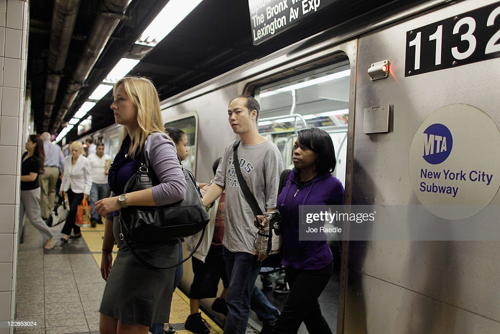 Commuters step off the subway August 29, 2011 in New York City. One day after Hurricane Irene hit New York the mass transit system, including subways and buses, began moving again in a limited capacity in time for Monday's rush hour.