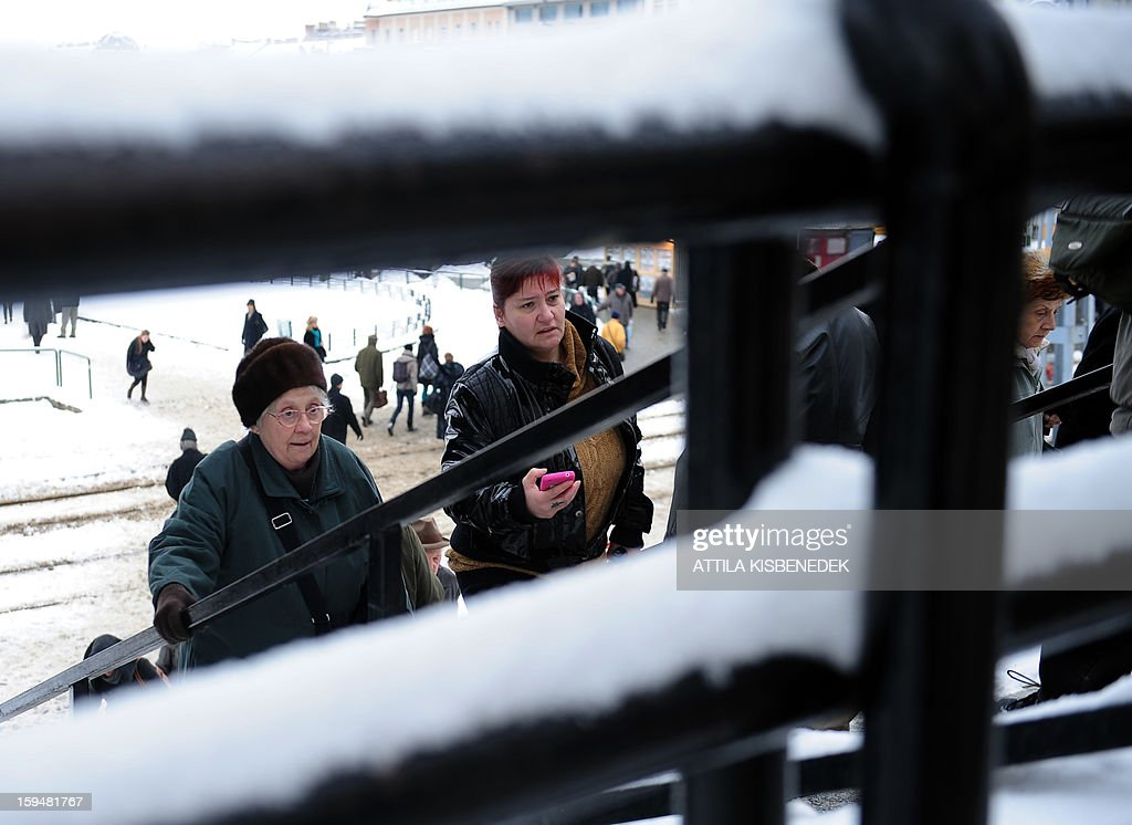 Commuters step up stairs in Budapest, 12th district on January 14, 2013 as the Hungarian capital and several counties were hit by about 20 cm snow last night and this morning. The heavy snowfalls caused chaos in traffic and public transport.