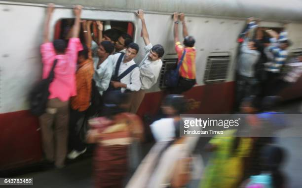 Commuters travel by local train in Mumbai on February 24 2010 as Indian Railways Minister Kumari Mamata Banerjee presents the railway budget for the...
