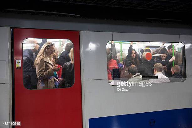 Commuters travel on the District Line of the London Underground which is running a limited service due to industrial action on April 30 2014 in...