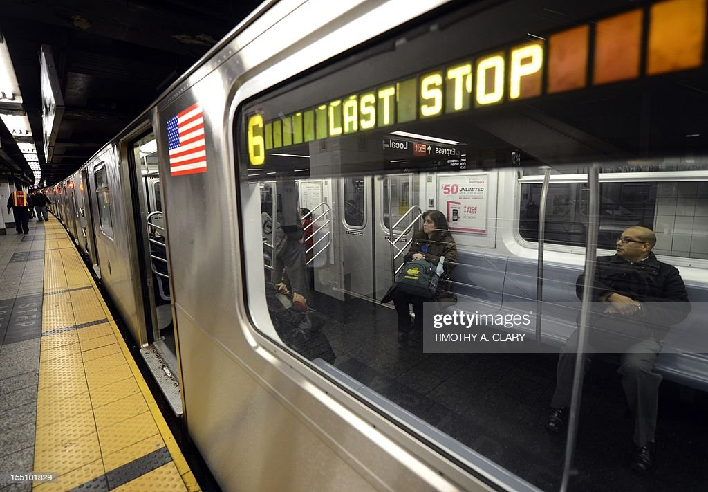 Commuters travel trough the 42nd Street subway station on November 1, 2012 in New York during the first day of limited subway after Hurricane Sandy. The storm left large parts of York City without power and transportation.