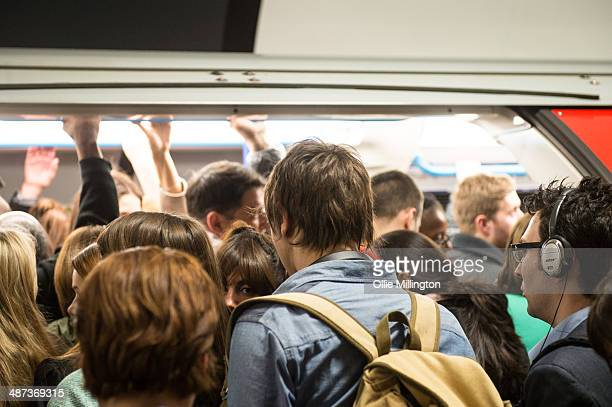 Commuters try to get onto a crowded train at Oxford Circus on the first day of a planned 48 hour underground train strike disrupting thousands of...