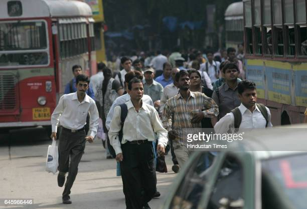 Commuters trying to catch bus outside Andheri station because of flash strike called by Auto and Taxi men to protest the increase in the prices of...