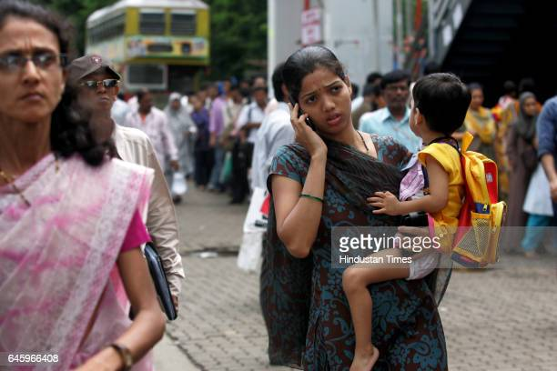 Commuters trying to catch bus Taxi outside Andheri station to drop their children at school because of flash strike called by Auto and Taxi men to...