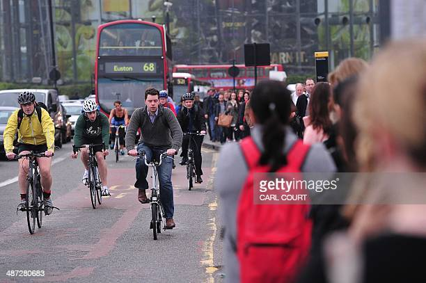 Commuters use bicycles to get to work as they cross Waterloo Bridge in London on April 29 as a planned 48 hour underground train strike came into...