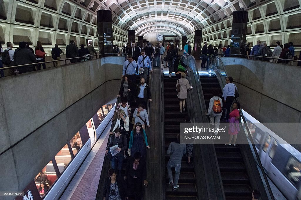 Commuters use the escalators at the L'Enfant Plaza station in Washington, DC, on May 24, 2016. Paul Wiedefeld, who used to run the Baltimore-Washington international airport, took over as Metrorail's new general manager in November 2015, assuming what was probably the least wanted job in the city at a really tense time. Wiedefeld has since presented a long-term maintenance plan to improve the system. / AFP / Nicholas Kamm