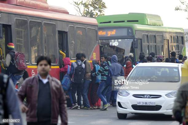 Commuters using buses autos to travel as Ola and Uber cab drivers go on strike on February 13 2017 in Noida India Starting as a driver centric market...