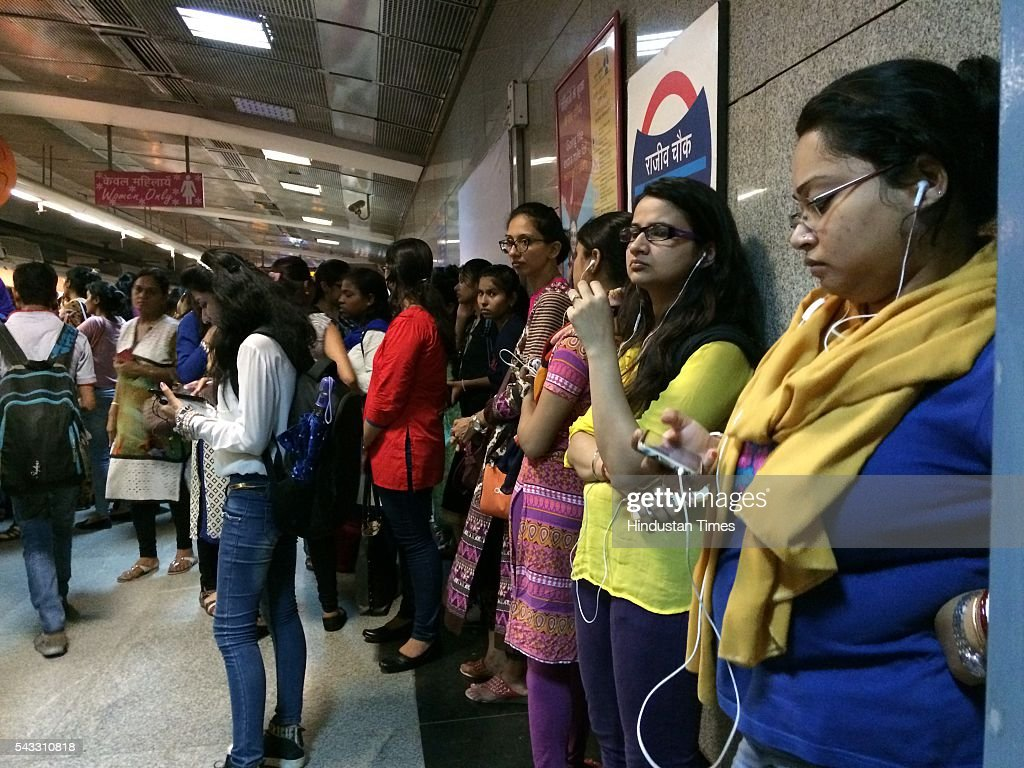 Commuters wait anxiously at Rajiv Chowk metro station as metro services halt due to a technical glitch on June 27, 2016 in New Delhi, India. Due to the breakdown of an overhead wire between Subhash Nagar and Tilak Nagar Metro stations, operations on the entire 51-km-long route remained affected for two-and-half hours.