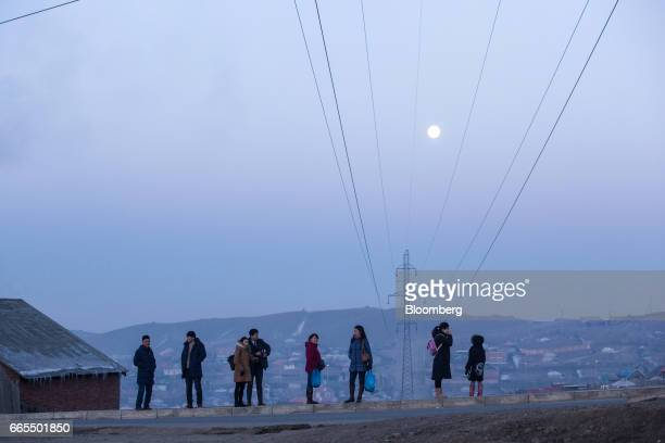 Commuters wait at a bus stop in a ger district of Ulaanbaatar Mongolia on Tuesday March 14 2017 The subzero winters in Ulaanbaatar force residents...