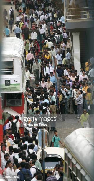 Commuters wait at a bus stop outside Andheri station because of flash strike called by Auto and Taxi men to protest the increase in the prices of CNG...