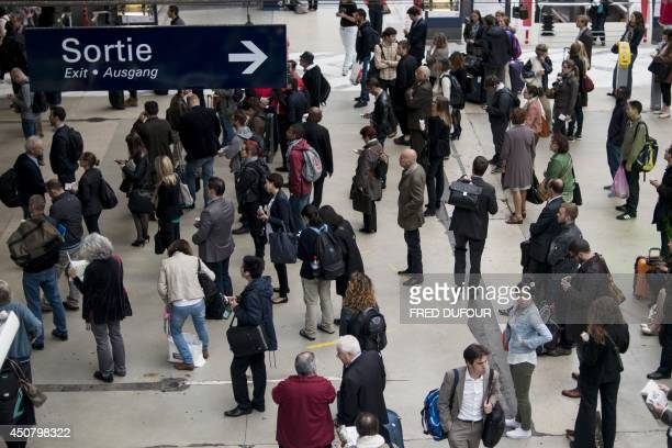 Commuters wait at Gare du Nord train station in Paris on June 18 during a national strike by French SNCF railway company employees Tensions rose in...