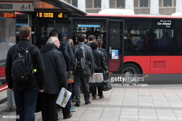 Commuters wait for a bus at Waterloo London on the second day of a 48 hour strike by tube workers on the London Underground over ticket office...