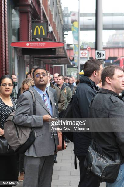 Commuters wait for a bus outside Waterloo station London on the second day of a 48 hour strike by tube workers on the London Underground over ticket...