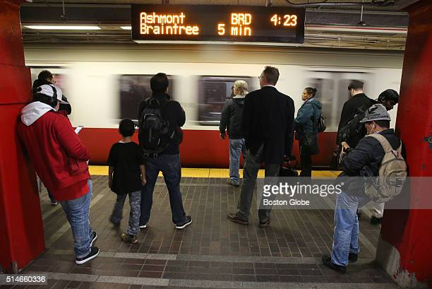 Commuters wait for a Red Line train at the Park Street T Station in Boston on Dec 22 2015