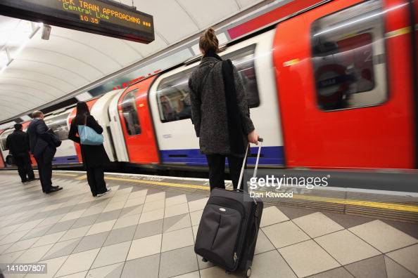 Commuters wait for a train at a London Underground station on March 5 2012 in London England London's underground rail system commonly called the...