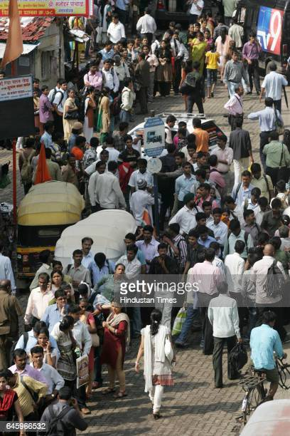 Commuters wait for bus stop outside Andheri station because of flash strike called by Auto and Taxi men to protest the increase in the prices of CNG...