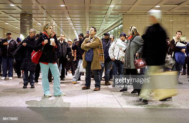 Commuters wait for information regarding departing LIRR trains in Penn Station on December 21 2005 in New York City Thousands of people who would...