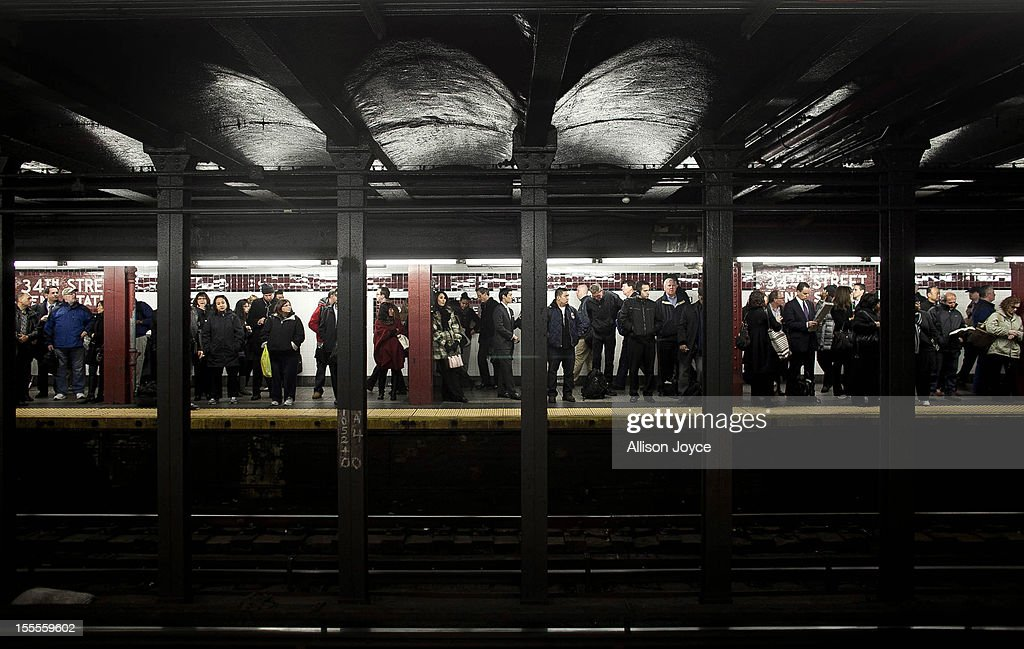 Commuters wait for the A train at Penn Station November 4, 2012 in New York City. A week after Superstorm Sandy hit the city, most of the subway lines are running, with some lines still suspended and others running on a limited basis.
