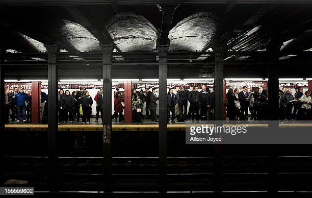 Commuters wait for the A train at Penn Station November 4 2012 in New York City A week after Superstorm Sandy hit the city most of the subway lines...