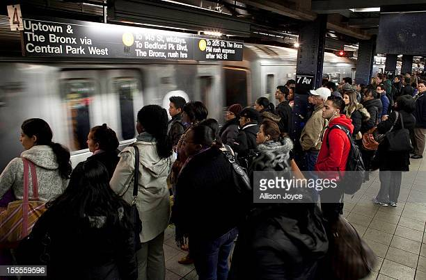 Commuters wait for the D train November 4 2012 in New York City A week after Superstorm Sandy hit the city most of the subway lines are running with...