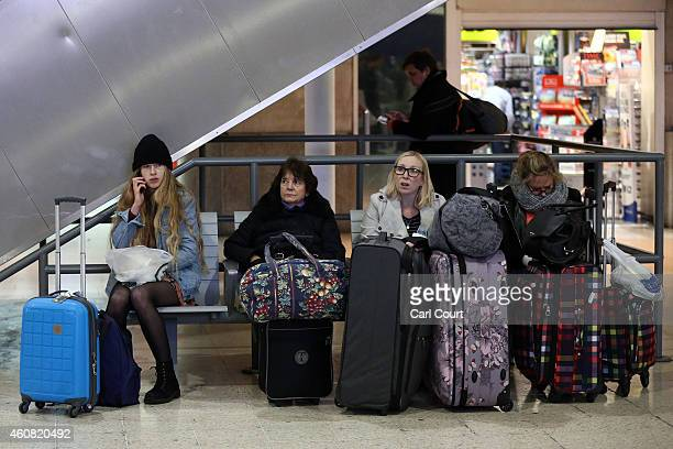 Commuters wait for trains at Waterloo Station on December 24 2014 in London England Although London buses run 24 hours a day throughout the festive...