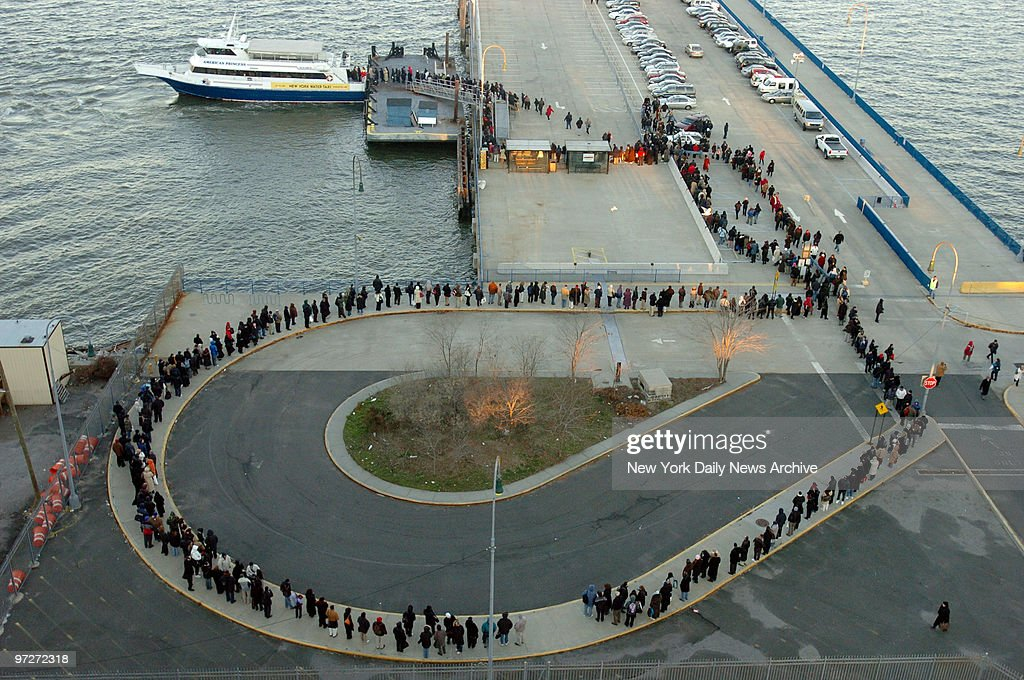 Commuters wait more than an hour and a half to board a Water Taxi at 58th St in Sunset Park Brooklyn to get into Manhattan on the first day of a...
