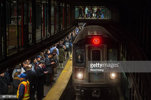 Commuters wait to board a 5 train to arrive at the 14th StreetUnion Square subway station in New York US on Thursday March 26 2015 It now costs $275...