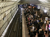 Commuters wait to board a Metrorail train at Union Station March 15 2016 in Washington DC Metrorail announced today that they will shut down service...