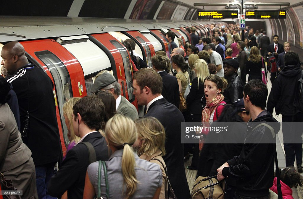 Commuters wait to board a tube train in Clapham Common station on one of the few London Underground services operating through the RMT Union's tube strike on June 11, 2009 in London, England. A 48 hour strike began at 7pm on Tuesday after discussions over pay and working conditions between London Underground bosses and the RMT Union failed to reach a conclusion.