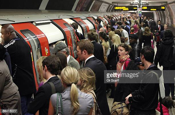 Commuters wait to board a tube train in Clapham Common station on one of the few London Underground services operating through the RMT Union's tube...