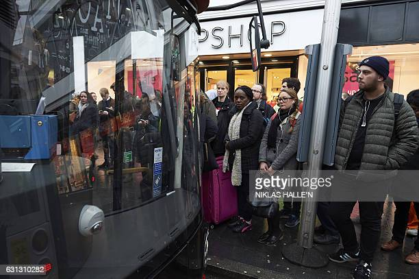 Commuters wait to board buses at bus stops in Brixton south London on January 9 2017 during a 24hour tube strike A strike on the London Underground...