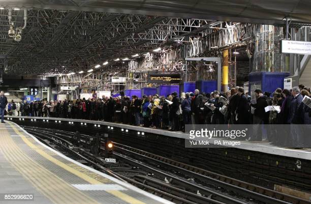 Commuters waiting for a train on a platform at Farringdon Underground station London during a 48hour tube strike as London Underground workers strike...
