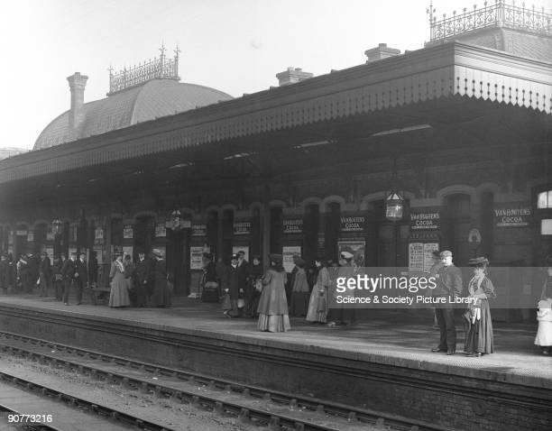 Commuters waiting for the Great Western Railway workmen's train These trains were run into large towns in the early morning and returned in the...