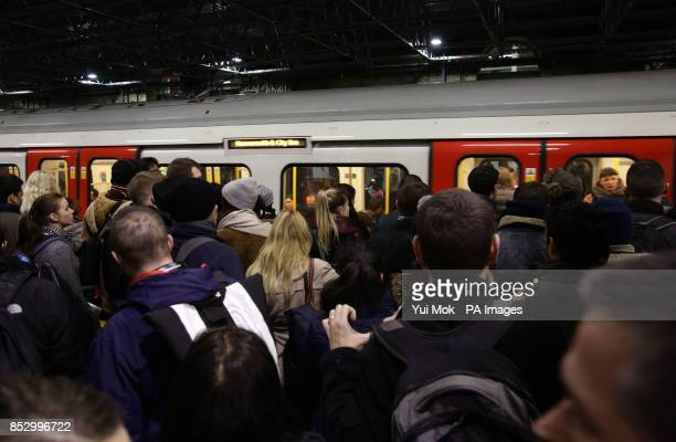 Commuters waiting to board a train at Farringdon Underground station London during a 48hour tube strike as London Underground workers strike over...