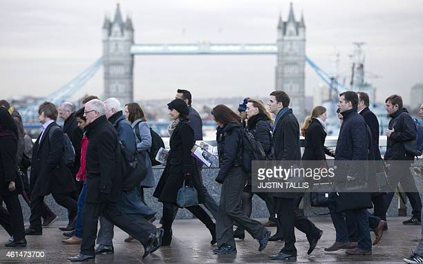 Commuters walk across London Bridge during a one day strike by bus drivers in London on Janurary 13 2015 Bus drivers from the vast majority of the...