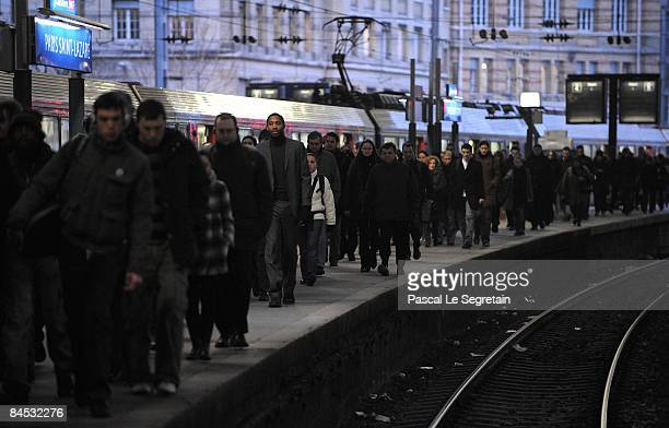 Commuters walk along a platform at Paris Saint Lazare railway station on January 29 2009 in Paris France Commuters were disrupted throughout France's...