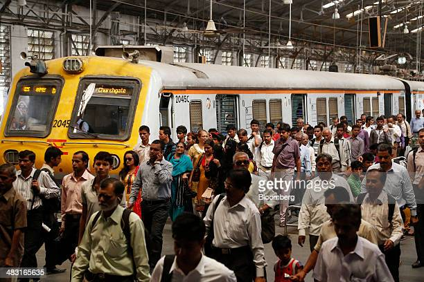 Commuters walk along a railway platform during the morning rush hour at Churchgate Station near the financial district of Mumbai India on Friday...
