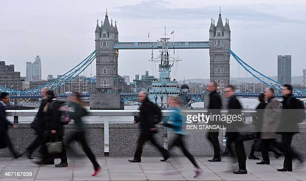 Commuters walk and jog across London Bridge in central London on February 6 on the second day of a strike by London Underground workers Millions of...
