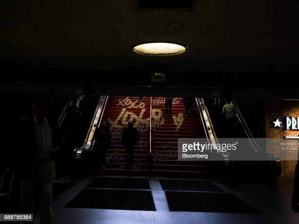 Commuters walk down stairs inside Pennsylvania Station in New York US on Friday May 26 2017 President Donald Trump tapped New York developer Steven...