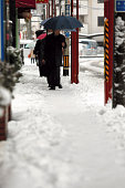 Commuters walk in the snow near the JR Tachikawa Station on January 18 2016 in Tachikawa Tokyo Japan A lowpressure system brought heavy snowfall to...
