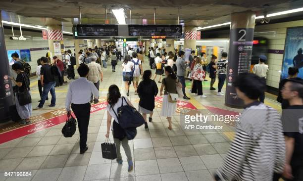 Commuters walk inside a subway station in Tokyo on September 15 2017 Millions of Japanese woke up in the early hours on September 15 as North Korea...
