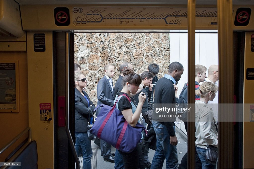 Commuters walk on a platform at the Denfert-Rochereau station in Paris on June 24, 2010 as a mass strike against the French government's plan to raise the retirement age disrupted transport. The bill raising the retirement age from 60 to 62 is due to be voted on in September.