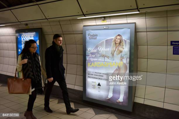 Commuters walk past a Protein World advertising poster featuring Khloe Kardashian at Monument underground station on February 20 2017 in London...