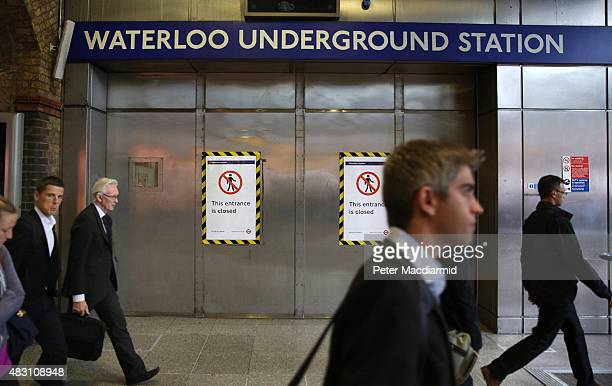 Commuters walk past the closed entrance to the Underground station at Waterloo station on August 6 2015 in London England London Underground workers...