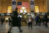Commuters walk through Grand Central station on January 22 2014 in New York City Snow and single digit temperatures made the morning difficult for...