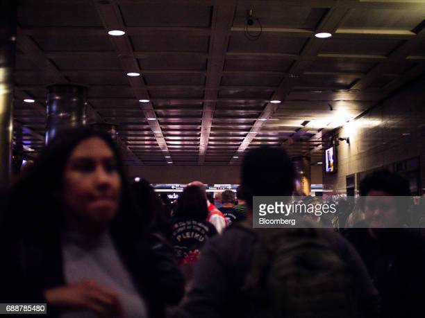Commuters walk through the Long Island Railroad Co concourse inside Pennsylvania Station in New York US on Friday May 26 2017 President Donald...