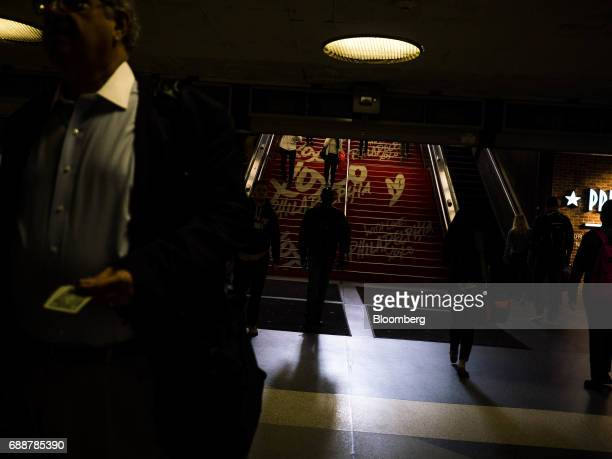 Commuters walk up stairs inside Pennsylvania Station in New York US on Friday May 26 2017 President Donald Trump tapped New York developer Steven...