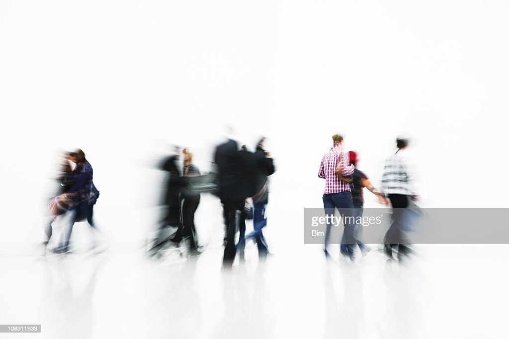Blurred People on White Backgroung, High Key : Stock Photo