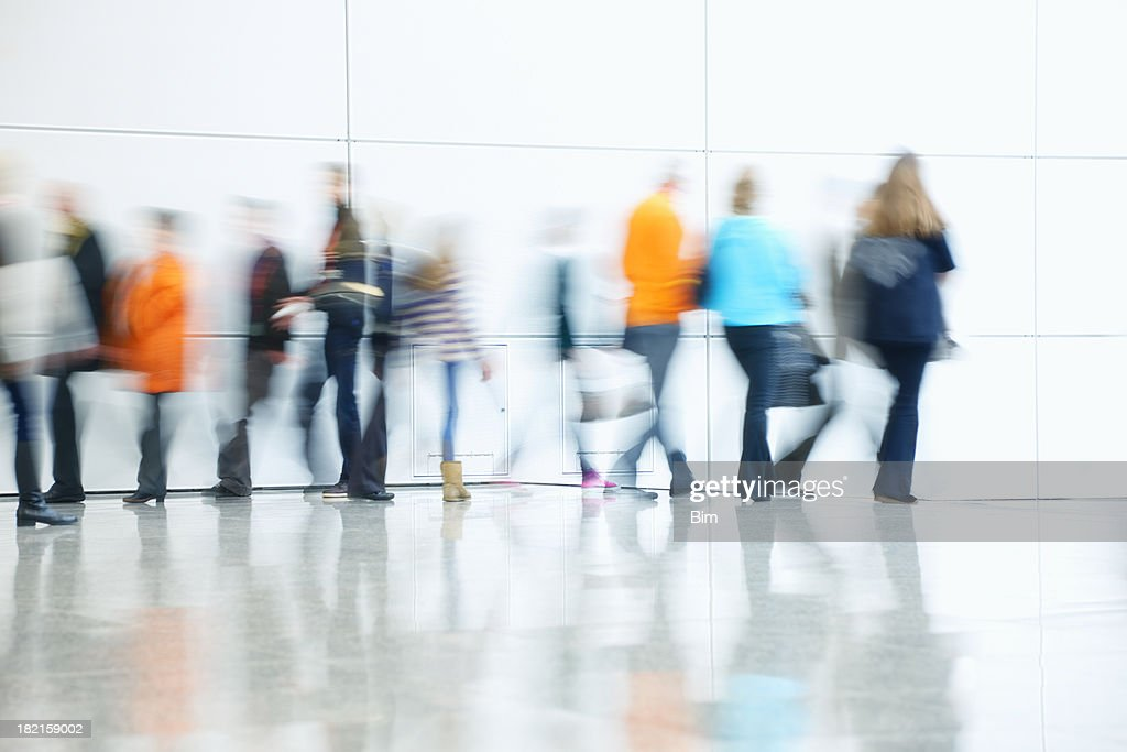 Commuters Walking in Corridor, Blurred Motion : Stock Photo